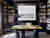 an elegant modern home office paired with a library and black bookcases plus a sleek contemporary desk