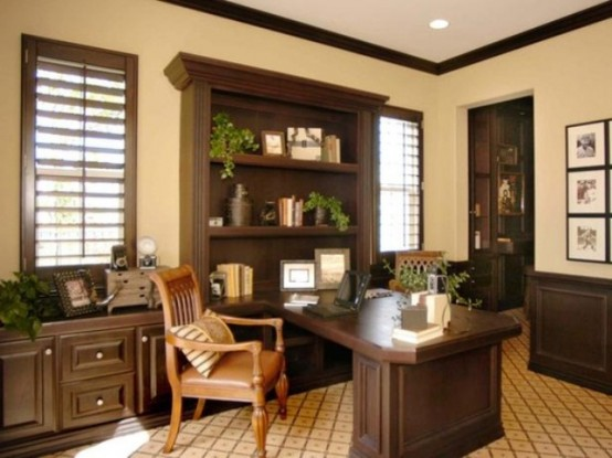 a vintage-inspired sandy and dark chocolate home office with stylish furniture, an amber leather chair and potted greenery