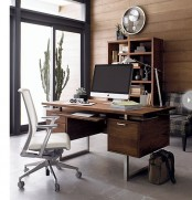 a stylish contemporary home office done with a wood statement wall, a wooden desk, a plaid chair and a potted cactus