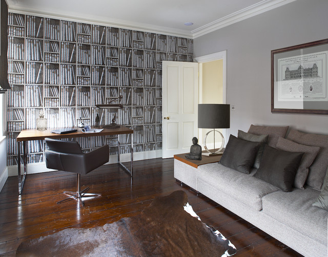 a contemporary home office with a statement wallpaper wall, a sleek desk with a leather chair, a comfortable sofa for napping