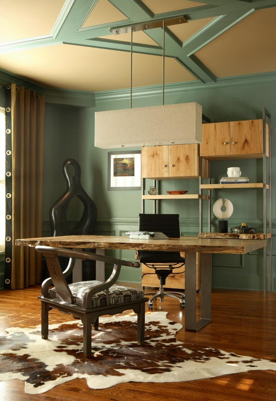 a catchy home office done with aqua touches, a metal and wood desk, an animal skin rug, a unique shelving unit with open shelves and cabinets