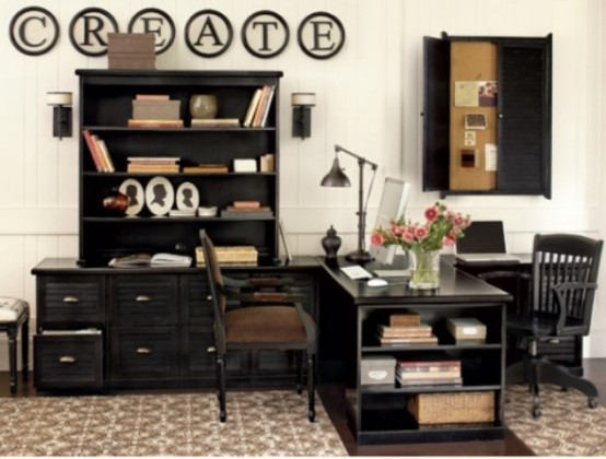a contrasting vintage-inspired home office with black furniture, a shutter pinboard, a large desk and an artwork