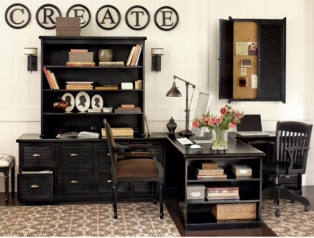 a contrasting vintage inspired home office with black furniture, a shutter pinboard, a large desk and an artwork