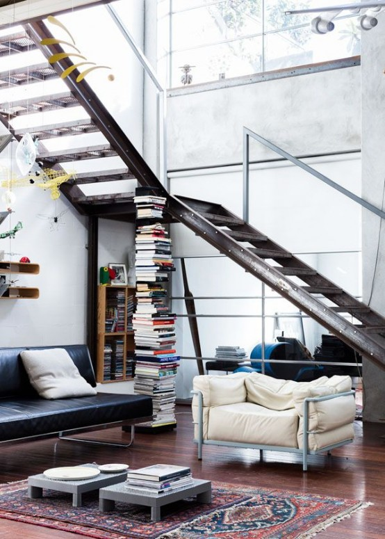 a gorgeous aged metal staircase makes a statement, metal furniture echoes with it and adds to the space