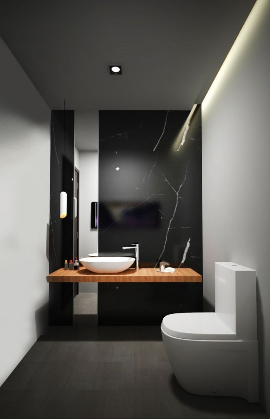 a refined minimalist powder room with a black marble wall, a floating vanity, white walls, white appliances and built-in lights
