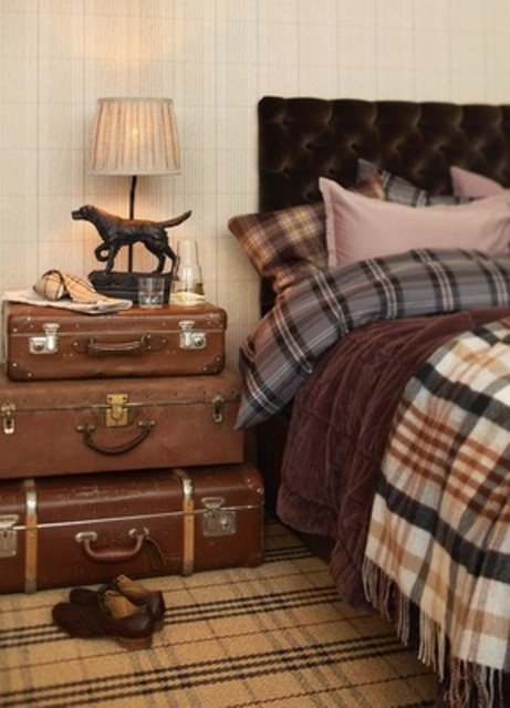 Vintage suitcases could easily become your bedside table. By the way, checked prints, are quite popular for masculine bedding sets.