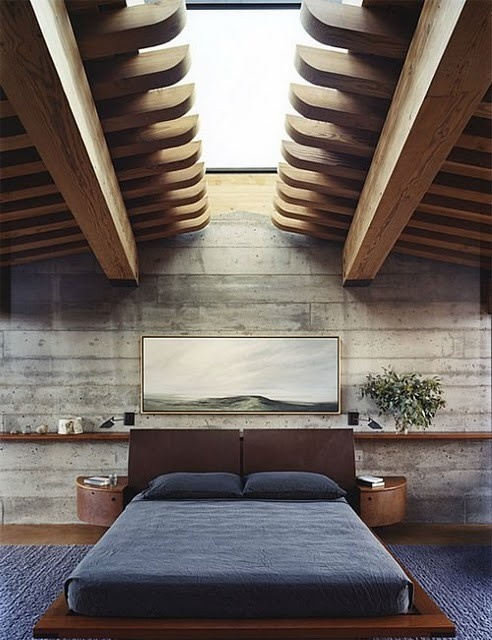 With such ceiling and rough concrete walls any bedroom would worth a real man.