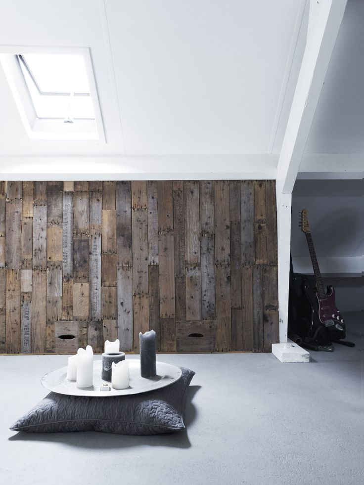a weathered wood wall is a great way to soundproof the space a bit and adds texture and color