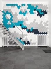 colorful hex acoustic tiles can be arranged in cool patterns that will highlight your decor style