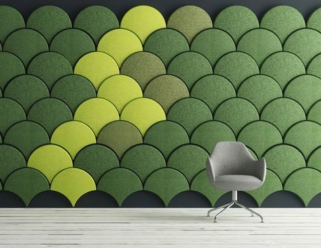 green and neon yellow acoustic fish scale panels make up a bold decor statemennt
