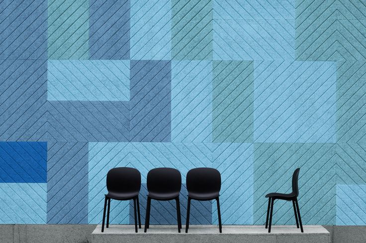 pastel colored geometric acoustic panels are a bold and chic ideda to decorate and sounnd proof the space