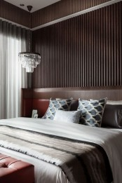a drywall can be covered with dark stained wooden planks like here, which will form a statement wall