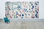 colorful hex acoustic panels arranged in a large artwork look very bold and chic