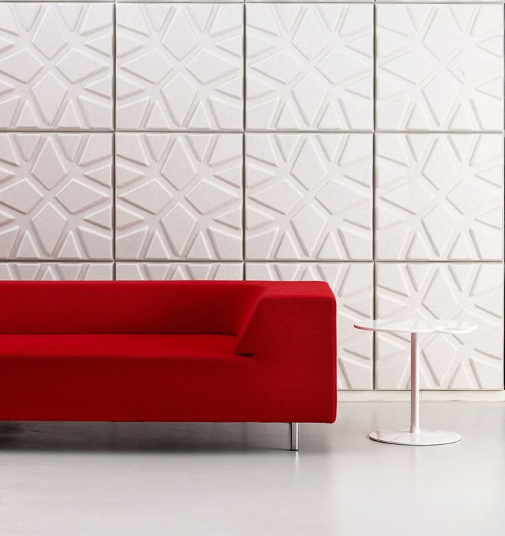 white acoustic panels add a pattern to the space while soundproofing it