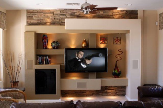 a sound proofing wall done with large shelves is a cool idea