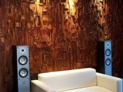 a wood covered wall is a bold statement and a chic idea for decor and soundproofing