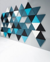 colorful triangle acoustic panels will soundproof the space and add eye-catchiness