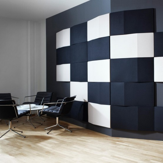 bold black and white rectangular tiles create a contrasting artwork on the wall