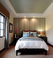 a soundproofing headboard wall done with large neutral-color panels that also form a statement wall