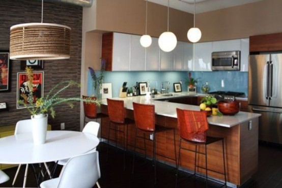 a rich-stained and white mid-century modern kitchen with a blue backsplash, pendant lamps and tall stools