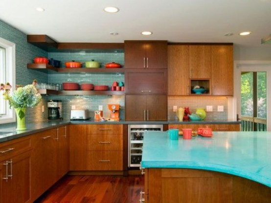 a turquoise and rich-stained mid-century modern kitchen with an arched kitchen island with a turquoise countertop