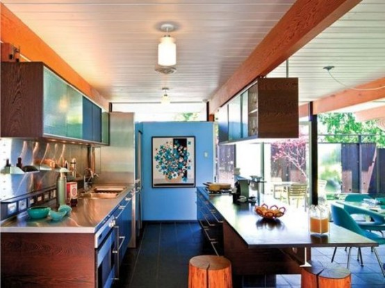 a mid-century modern kitchen with rich-stained cabinets, a large kitchen island with an eating space and uppers over it