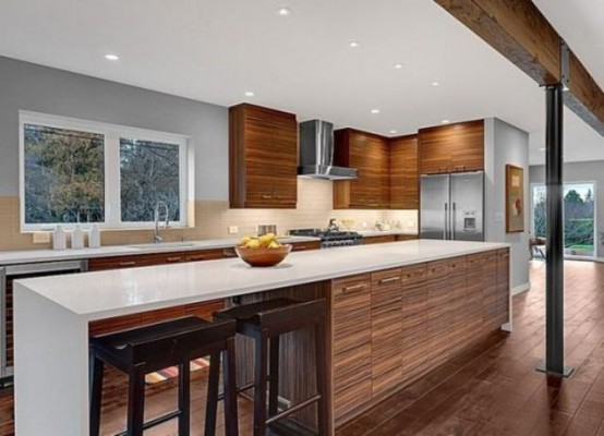 a rich-stained and white mid-century modern kitchen with a large kitchen island with an eating space