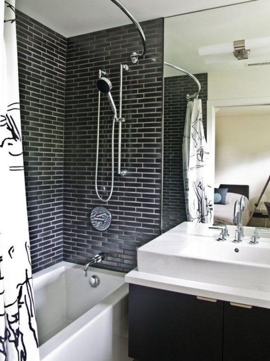 a modern bathroom with a faux grey brick wall, a mirror, a floating vanity and a white sink plus a curtain