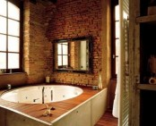 rough brick walls make this modern bathroom bolder and cooler, and a framed window gives light