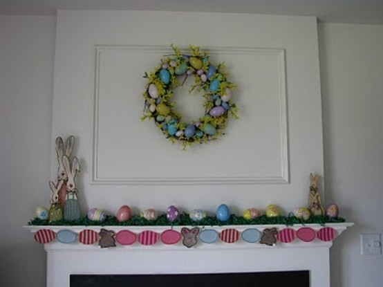 a colorful egg garland, bright fake eggs, a pastel egg wreath and bunny figurines