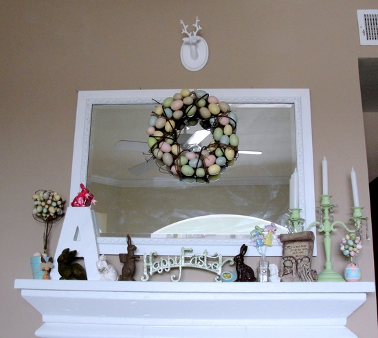 a pastel egg wreath and topiaries, bunny figurines and some monograms