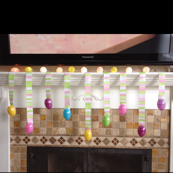 colorful fake Easter eggs hanging on bright masking tape is a simple Easter decor idea
