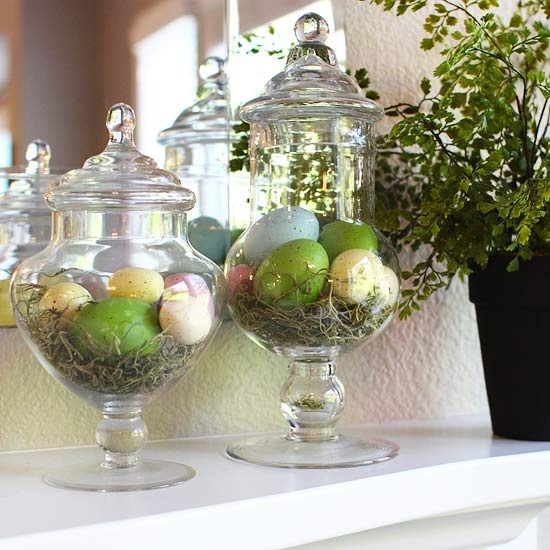 large jars with hay and colorful Easter eggs on the mantel is a cute and easy to realize idea