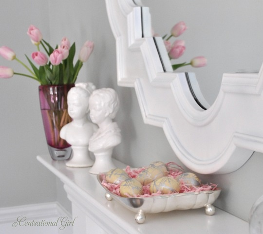 elegant Easter mantel styling with pink tulips and a silver tray with metallic eggs