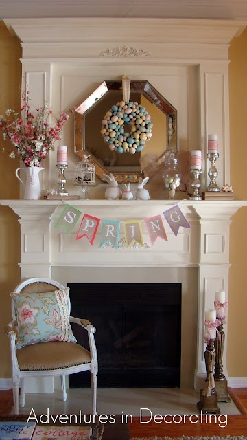 a colorful bunting, a pastel faux egg wreath, some candles and fake bunnies