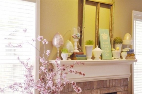 a pastel Easter mantel with faux eggs, egg arrangements in a bowl and grass in pots