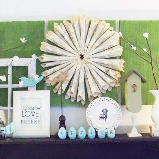 a blue Easter mantel with fake eggs and birds, some bunnies and branches with fake flowers