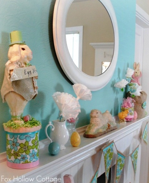 a colorful vintage Easter mantel with paper blooms, fake bunnies and eggs