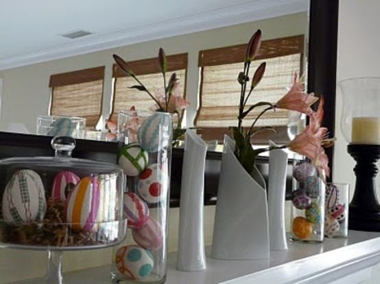 colorful fake eggs in cloches and pink lilies in vases for a fresh Easter look