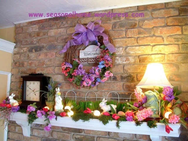 a super colorful Easter mantel with grass, foliage and blooms and with bunny figurines