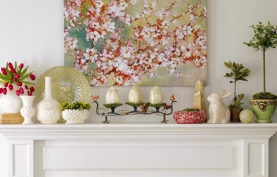 a sweet pastel Easter mantel with fake eggs and bunnies, some greenery and tulips
