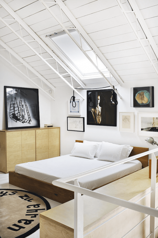 Stylish Eclectic Loft With Clusters Of Art And Framed Photographs