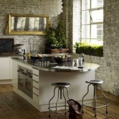 whitewashed brick walls make the kitchen less formal and add texture to the walls
