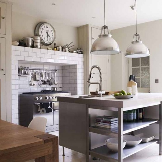 white tiles around the cooker are imitating the bricks and look bold and catchy, besides they are easy to clean