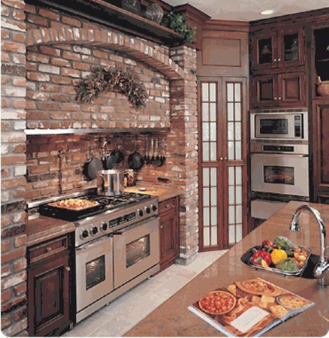 a red brick cooker backsplash and wall plus rich stained wooden furniture for an elegant rustic kitchen
