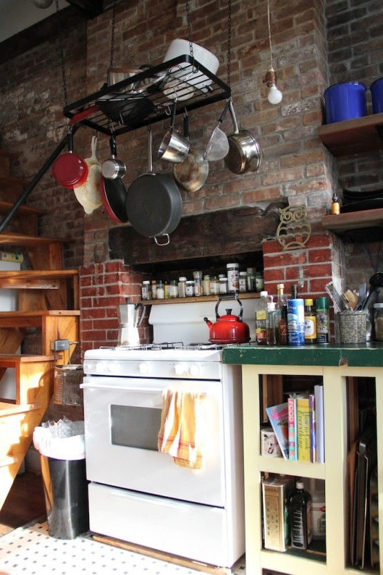 a whitewashed red brick wall is a cool idea for an eclectic kitchen like this one