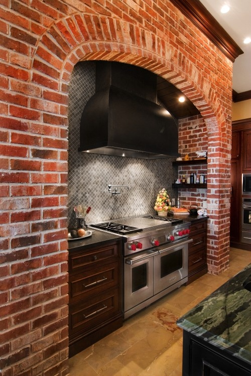 a red brick cooker backsplash with shelves and grey tiles make up the space chic and textural