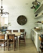 a faux brick wall in the dining space add interest and texture to the space making it catchier