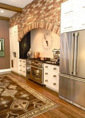 red and white bricks with an arched wall over the cooking zone for a vintage and rustic feel