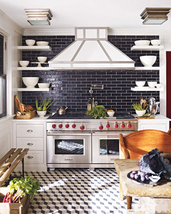 navy tiles with white grout that imitate bricks and contrast the white cabinets making them stand out